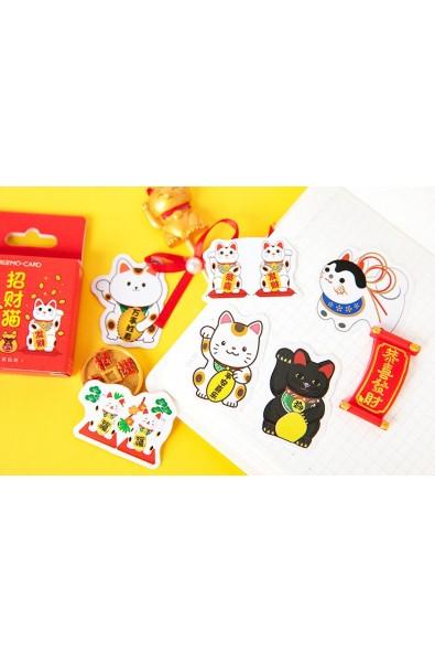 Naklejki w pudełeczku z Maneki Neko i japońskimi napisami